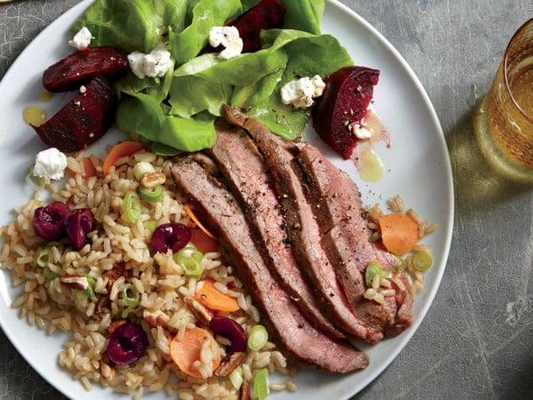 Grilled Flank Steak with Cherry-Pecan Rice #steak #recipe #dinner