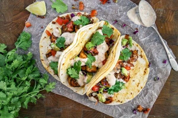spicy shrimp tacos + sour cream cilantro sauce #tacotuesday #taco #recipe #dinner