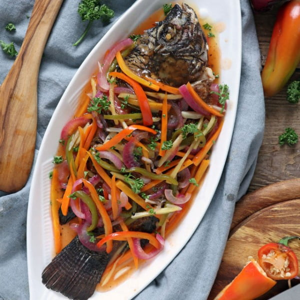 Make this colorful, tangy-sweet Filipino Escabeche or Sweet and Sour Fish and bring your plain fried fish to the next level of goodness. #recipe #food #dinner #sweetandsour