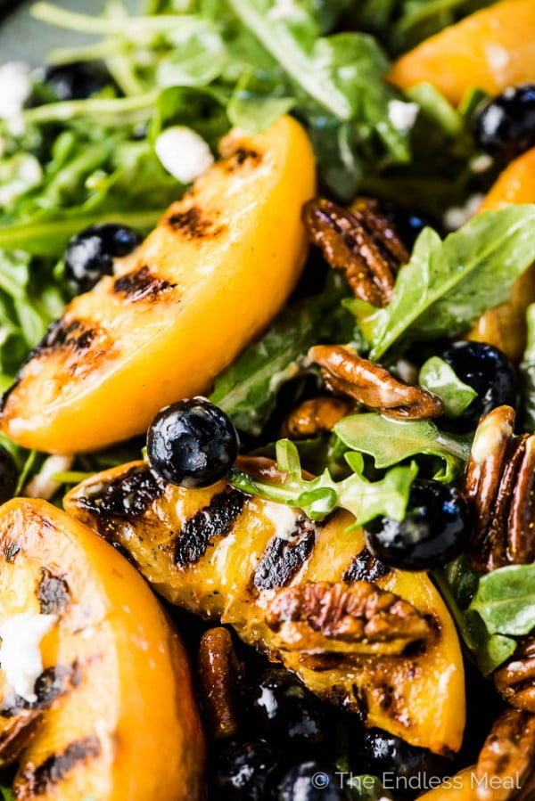 Grilled Peach Salad with Curry Pecans & Honey Vinaigrette #vegetarian #salad #recipe #healthy