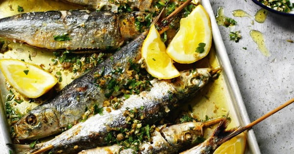 Grilled sardines with coarsely chopped green herbs #grilled #fish #grill #dinner #recipe