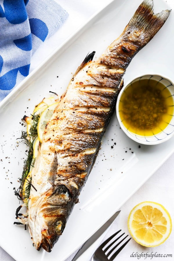 Grilled whole Branzino with Lemon Caper Sauce #grilled #fish #grill #dinner #recipe